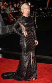 Ellie Goulding was all-out glam at the 'Catching Fire' London premiere in a patterned black Pamella Roland gown with see-through panels, a front slit, and a long train.
