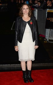 Nina Jacobson contrasted her delicate lace dress with a tough-looking black leather jacket when she attended the 'Catching Fire' London premiere.