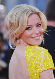 Elizabeth Banks wore her hair in a romantic updo with subtle loose waves at the European premiere of 'The Hunger Games.'