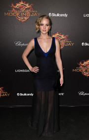 Jennifer Lawrence did some sexy layering for the 'Hunger Games' cast party in Cannes, wearing a sheer black Dior gown over a blue mini dress.