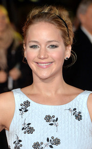 Jennifer Lawrence looked mildly retro with her teased updo, complete with a headband, during the 'Hunger Games: Mockingjay Part 1' premiere.