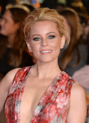 Elizabeth Banks opted for a classic French twist when she attended the 'Hunger Games: Mockingjay Part 1' premiere.