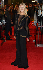 Kimberley Garner looked seductive at the 'Mockingjay' London premiere in a black sheer-panel gown that bared her cleavage (and more).