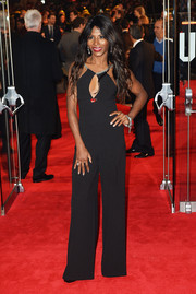 Sinitta looked foxy in a black jumpsuit with a sultry keyhole neckline during the 'Hunger Games: Mockingjay Part 1' premiere.