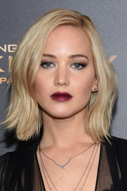 Jennifer Lawrence went for a sexy-goth beauty look with a dark berry lip.