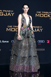 Jena Malone attended the 'Hunger Games: Mockingjay - Part 2' world premiere wearing this stunner of a gown, boasting a dazzling combination of sparkly beads and floral appliques.
