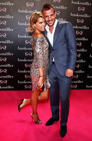 Rafael Van Der Vaart looked super suave in his gray suit at the Hunkemoeller show.