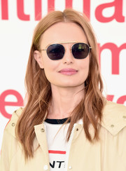 Kate Bosworth hid her eyes behind a pair of round shades while posing for photographers.