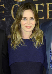 Emily Blunt kept her beauty look subtle with some lipgloss and pink blush.