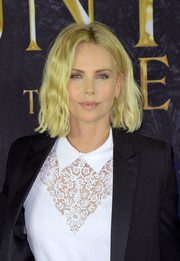 Charlize Theron looked radiant with her blonde waves at the photocall for 'The Huntsman & The Ice Queen.'