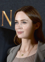 Emily Blunt wore her hair down with a center part for the 'Huntsman: Winter's War' photocall.