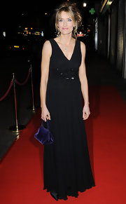 Natascha opted for a small evening bag to accompany her black floor-length dress. The velvet purple bag was a nice touch.