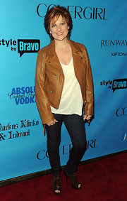 Caroline Manzo went for a youthful rocker-chic feel with a tan leather jacket, skinnies, and peep-toe boots at the ICONS Exhibition.