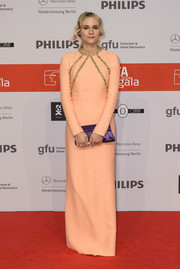 Diane Kruger looked very refined in a long-sleeve peach Prada dress with gold accents on the bodice during the IFA opening gala.