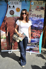 Gina Gershon got deglammed in a white V-neck tee and jeans at the LAUSD Love Elephants Youth Art Exhibit.