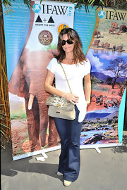 Gina Gershon's snakeskin and suede chain-strap bag added a dose of elegance to her casual ensemble at the LAUSD Love Elephants Youth Art Exhibit.