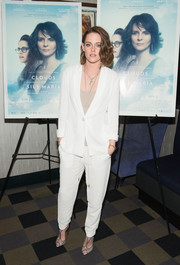 Kristen Stewart donned a white pantsuit over a casual tank top for a relaxed and effortless look.