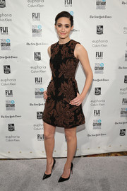 Emmy Rossum made an appearance at the Gotham Independent Film Awards wearing a brown and black baroque-print dress by Simone Rocha.