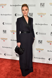 Julia Stiles complemented her gown with a black satin purse, also by The Row.