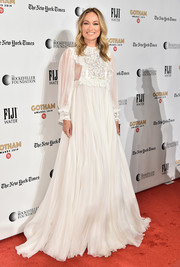 Olivia Wilde looked angelic in a long-sleeve white empire gown by Miu Miu at the 2019 Gotham Independent Film Awards.