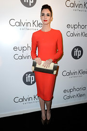Paz Vega chose a long-sleeve orange dress for a sleek and contemporary look at Calvin Klein's Celebration of Women in Film in Cannes.