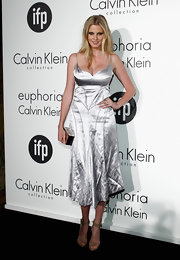 Lara Stone showed off her fierce curves in this silver cocktail dress at the Women in Film celebration.