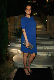 Carmen Chaplin carried this gray leather clutch with her blue dress at the Women in Film celebration.