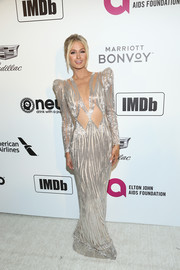 Paris Hilton rocked a shimmering cutout gown by Mikael D at the Elton John AIDS Foundation Oscar-viewing party.