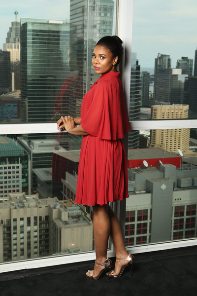 Regina Hall looked ultra feminine in a caped red cocktail dress at the IMDb Studio during the 2018 Toronto International Film Festival.