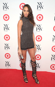 Joan Smalls paired a sleeveless gray turtleneck with black cutoffs for the IMG + Target official NYFW kickoff.