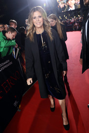 Rita Wilson arrived for the German premiere of 'Inferno' wearing a simple black coat over a beaded velvet dress.