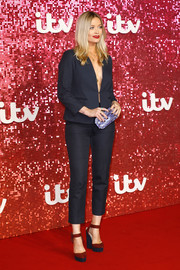 Laura Whitmore styled her look with a pair of red and navy platform pumps.