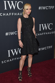 Christina Ricci complemented her dress with a pair of black lace-up heels, also by Alaia.