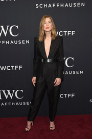Rosamund Pike rocked a bold-shouldered, deep-V jumpsuit by Bottega Veneta at the IWC Schaffhausen Tribeca Film Fest event.