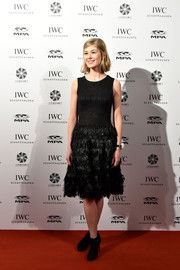 Rosamund Pike opted for a pair of black booties to finish off her look.