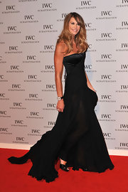 Elle MacPherson attended an IWC launch in black satin pumps adorned with feminine rosettes.
