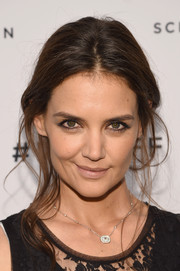 Katie Holmes looked a little pale with her nude lipstick.