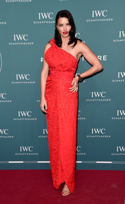 Adriana Lima looked striking in a bright red one-shoulder gown by Brandon Maxwell at the 2019 IWC Schaffhausen Gala.