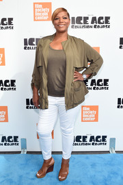 Queen Latifah opted for a casual tan jacket layered over a matching shirt when she attended the New York screening of 'Ice Age: Collision Course.'