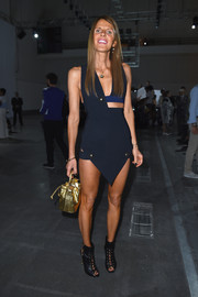 Anna dello Russo went for a bold and sexy vibe in a navy Anthony Vaccarello cutout dress during the Iceberg fashion show.