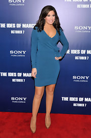 Kimberly Guilfoyle looked alluring at the premiere of 'The Ides of March' in a teal sweater dress that played up her fab curves.