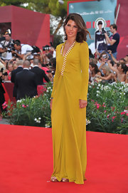Marisa Tomei donned an elegant long-sleeved gown at 'The Ides of March' premiere in Venice. The mustard frock was perfectly draped and even included a pearl-embellished neckline.