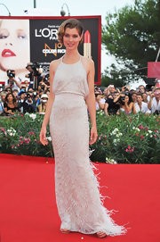 Vittoria Puccini stunned in a intricately beaded gown. The halter frock with a banded waist, head-to-ted beading and feathered hemline was just the right amount of drama for the Venice Film Festival.