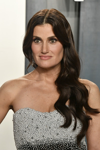 Idina Menzel Side Sweep [hair,hairstyle,eyebrow,shoulder,long hair,beauty,brown hair,chin,lip,dress,idina menzel,radhika jones - arrivals,hair,hairstyle,fashion,eyebrow,wallis annenberg center for the performing arts,oscar party,vanity fair,party,idina menzel,wallis annenberg center for the performing arts,oscar party,vanity fair,86th academy awards,party,wicked,fashion]