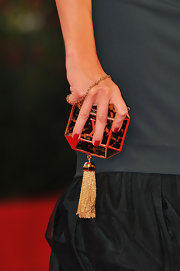 Violante Placido arrived at the premiere of 'Il Vilaggio di Cartone' holding a Louis Vuitton hard case clutch.
