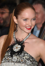Lily Cole completed her fancy ensemble with a pair of dangling geometric earrings at the UK premiere of 'The Imaginarium of Doctor Parnassus.'