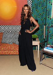 Iman showed off her black jumpsuit while hitting the launch off her IMAN Home collection.