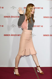 "Leslie Mann chose brown leather ankle-strap Marni pumps for a ""This Is 40"" photocall."