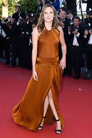 Ana Girardot's burnt brown gown featured a front leg slit, a drop waist, and a ruched halter neck.
