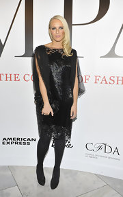 Keren Craig topped off her sparkling frock with black tights and black suede platform pumps.